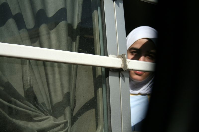 Jordanian schoolgirl on a bus